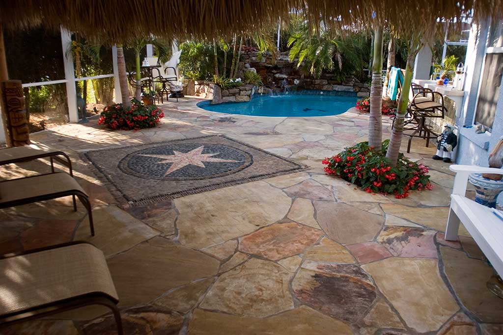 Lagoon pool remodel with natural stone waterfalls and flagstone deck designed and built by Lucas Lagoons Inc. in Bradenton, FL