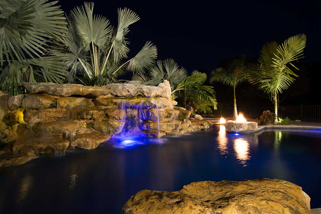 Natural Lagoon built with Florida Limestone having multiple waterfalls, grottos and fire features, designed and built by Lucas Lagoons Inc