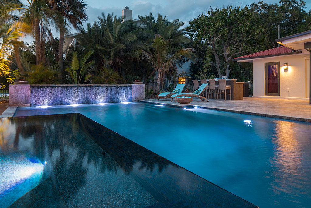 Lucas Lagoons modern pool and spa with an infinity edge, waterwall, deck and fire feature
