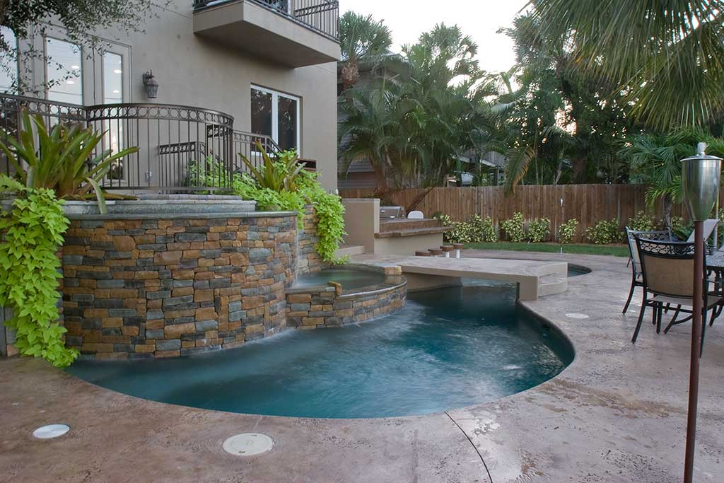 Lagoon pool with spa, bridge, and bar area designed and built in Siesta Key Florida by Lucas Lagoons Inc.