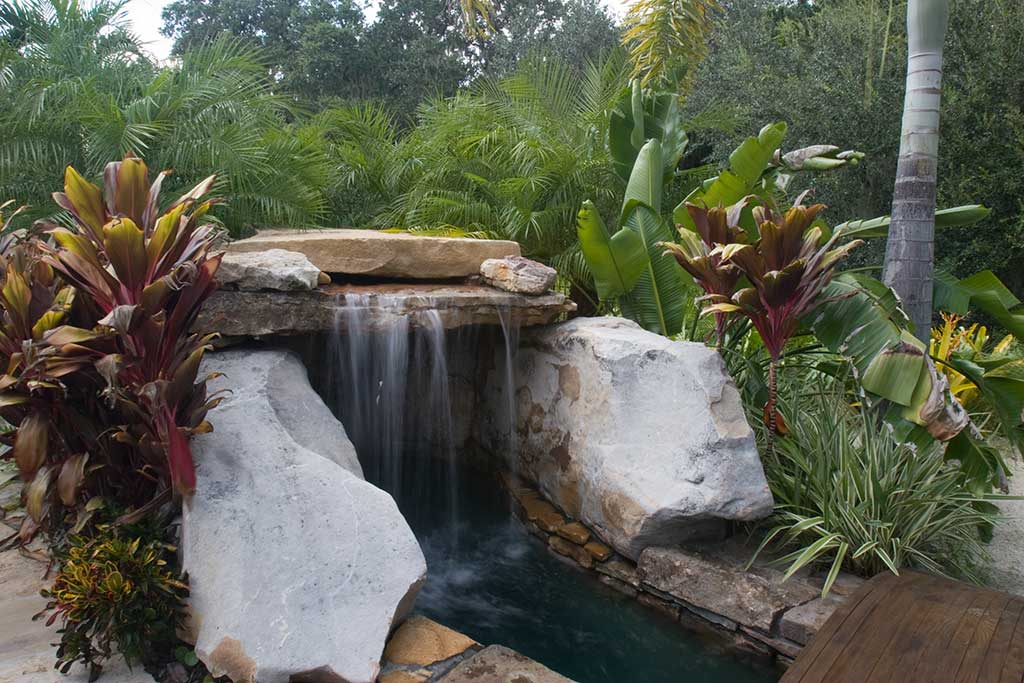 Lagoon Pool with grotto and elevated spa waterfall by Lucas Lagoons Inc.
