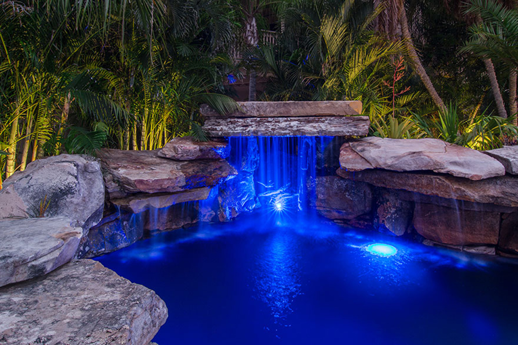 Lucas Lagoons pool with rock grotto, rock bridge, travertine deck and Koi pond as seen on Insane Pools: off the deep end