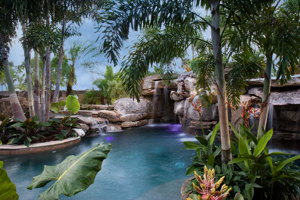 Lagoon pool and spa with natural Tennessee field stone grotto water feature, in Sarasota, Florida designed and built by Lucas Lagoons Inc.